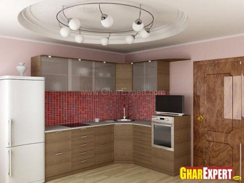 small L shaped open kitchen with under counter storage cabinets and overhead storage cabinets
