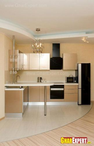 L shaped open plan small kitchen with breakfast counter