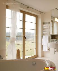 Ceiling height window with glass in bathroom