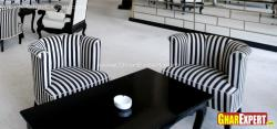 Black and white striped sofas