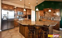 brown colored kitchen  with bar counter and chairs