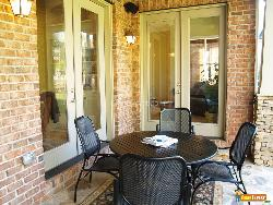 Wood and metal table chair on covered stone patio