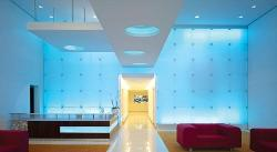 T style ceiling design in blue painted room