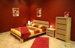 Bedroom furniture in teak and red colored paint on walls