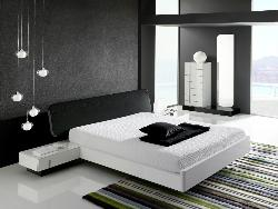 Black colored bedroom furniture including wardrobes and chests with wooden flooring