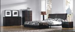 Wenge colored bedroom furniture including wardrobes and chests with wooden flooring