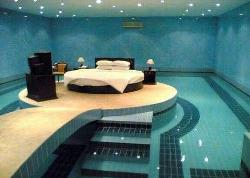 Bed in the middle of Swimming Pool