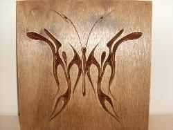 Engraved butterfly design on wood