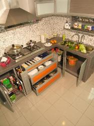 Opened cabinets in modular kitchen