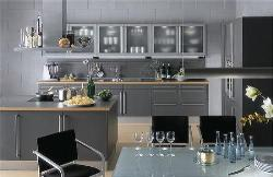 Modular kitchen design with cook top and hood at the center of the kitchen