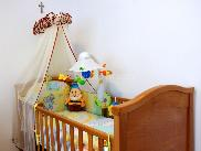 Baby bed with toys