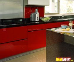 kitchen cabinets in stunning red theme with black marble stone top