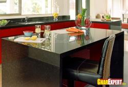 Kitchen island made with black marble stone