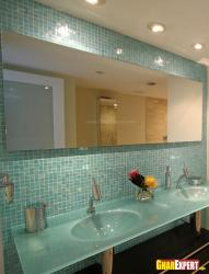 Bathroom tiles in blue color with a large mirror on wall