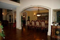 Arch design in lobby with wooden flooring and traditional dining furniture