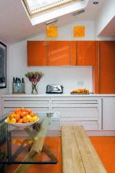 Exotic modern glossy orange and white colored cabinets for kitchen with skylight