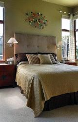 Single Bed design with upholstered headboard and large windows for ventilation