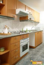 Wooden Cabinets in Kitchen with white colored cooking range and hood