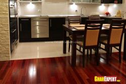 tile floor for open kitchen and wooden floor for dining area