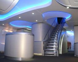 Ceiling design with blue colored LED lighting for commercial space