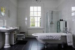 White Marble in Bathroom.