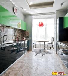 Tiled flooring in balck and green kitchen