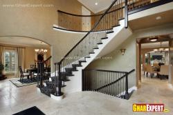 Curved stairs design near dining room