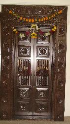Wooden carved pooja room door design