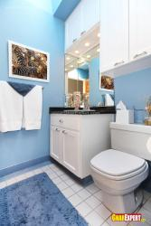 White vanity in blue colored bathroom