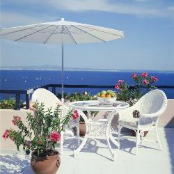 Umbrella covered outdoor patio furniture