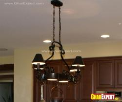 Wrought iron small chandelier on the kitchen island