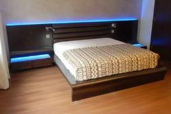 Led lighting at the bed headboard