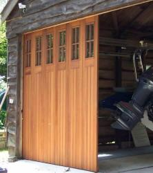 Sliding garage door in wood with top windows