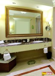 Antique mirror over the bathroom sinks in modern bathroom