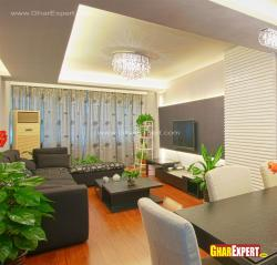 Interior plants and black upholstered sofa set for living room