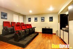Home theatre with multi-sitting and hardwood flooring
