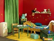 Red walls with floral pattern and a high shelf holding books and toys