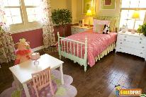 Multicolored carpet, flowery curtain and chest with metal coded handles provide your kids room extra variety