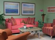 Well Decorated Living room with Colourful Sofa and Pillows
