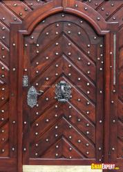 crafted wooden main door design