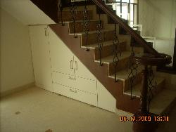Round ending of stairs with veener on sides of steps incld storage under staircase