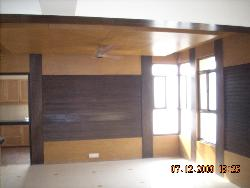 Wall panelling & wooden ceiling in family lounge at upper lvl