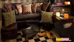 two seater leather sofa with small ottoman for living room