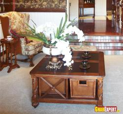 Honey wooden polish on center table with wicker storage