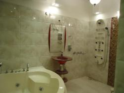 Bathroom in large space with Jacuzzi and shower panel