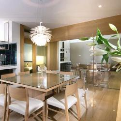 Wooden floor and wooden wall cladding in dining room