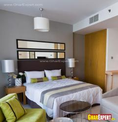 Simple modern bed design with side lamps