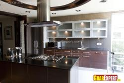 Modular kitchen with cooktop on the center island