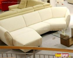 Modern orange curved sectional with small ottoman