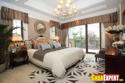 master bedroom with large space and brown walles